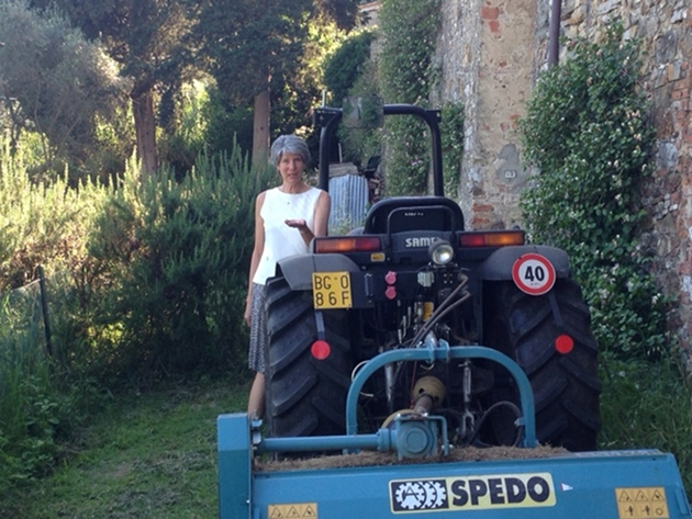 Author Lynn Rodolico with her tractor at Villa Arrigo. Photo by Trisha Thomas