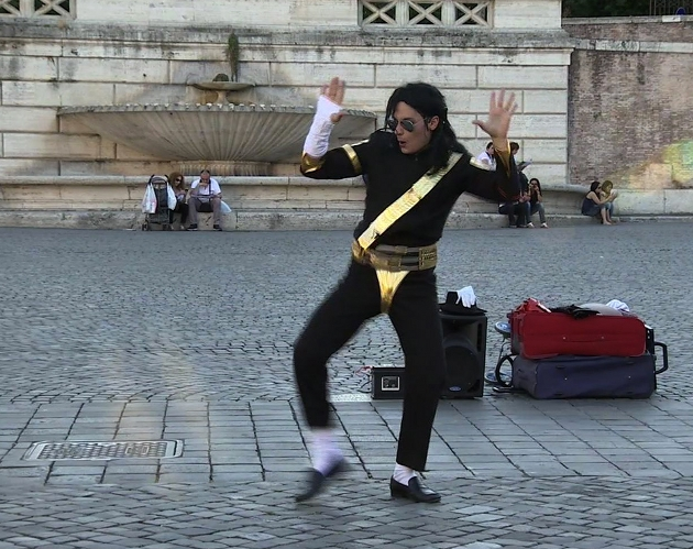 Emiliano Fiacchi performing as Michael Jackson in Piazza del Popolo, Rome. June, 2013. Freeze frame of video shot by AP cameraman Paolo Lucariello