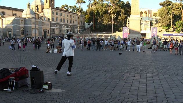 Emiliano Fiacchi, a Michael Jackson Imitator, performing for a crowd at Rome's Piazza del Popolo. Freeze frame of video shot by AP Cameraman Paolo Lucariello. June 2013