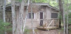 Log Cabin built by Henry Slayter in 1970 on Bog Lake in Down East Maine
