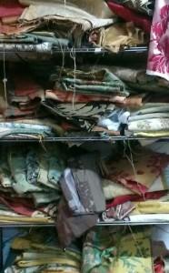 Pile of Damask Silk fabric on shelves in Rossana Petrillo's studio in Caserta, Italy. January 28, 2014. Photo by Trisha Thomas