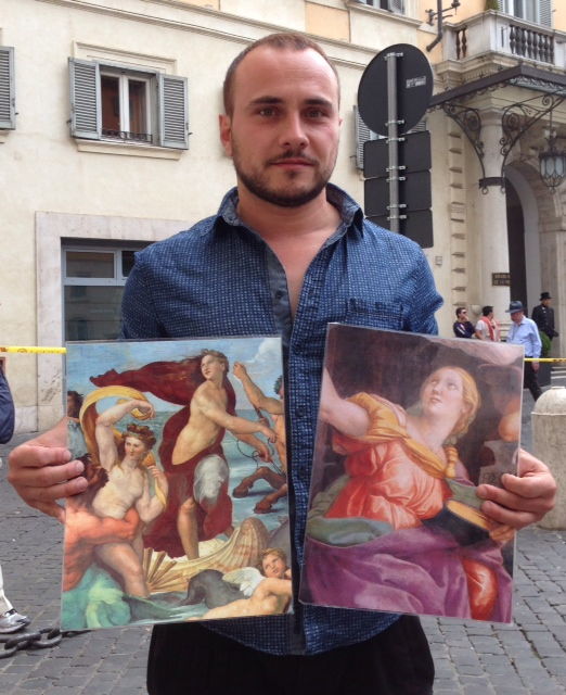 """Massimo De Filippis shows photos of two paintings by Raphael where he used the famous Roman courtesan Imperia as a model. """"The Triumph of Galatea"""" and """"Sibyl"""". Photo by Trisha Thomas, May 16, 2014"""