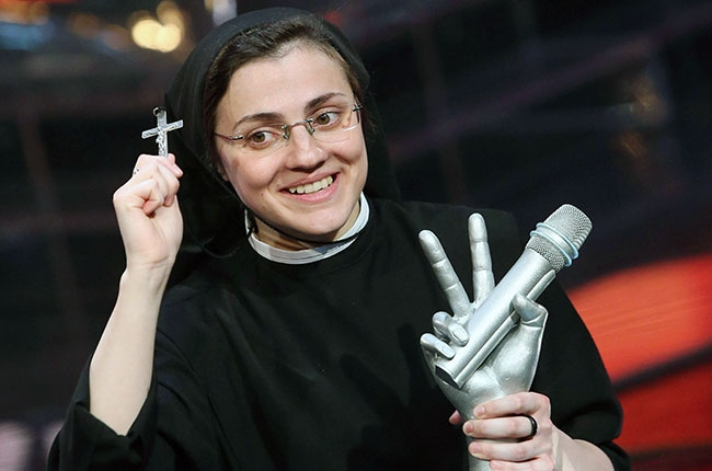 """The Singing Nun, Sister Cristina Scuccia shows her cross following her victory in """"The Voice of Italy"""" singing competition. June 5, 2014"""