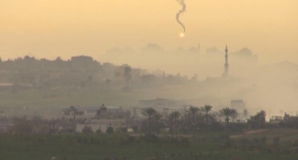 Freeze frame of video shot by Simone Camilli of an Israeli bomb falling on Gaza.