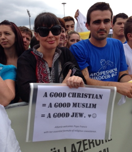 Woman waiting for Pope Francis at Mass in Tirana, Albania, September 21, 2014. Photo by Trisha Thomas