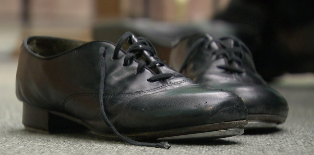 Father David Rider's well-worn tap dancing shoes waiting for him to put them on.  Freeze frame of video shot by Paolo Lucariello. October, 2014