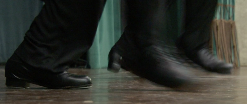 The dueling dancing feet of Father David Rider and Father John Gibson. Freeze frame of video shot by ApTN cameraman Paolo Lucariello. October 2014