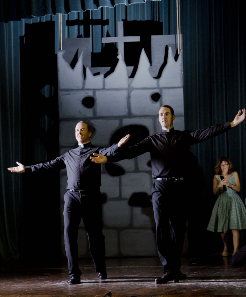Father David Rider and Father John Gibson dancing at the North American College Rome, Monday, Oct. 13, 2014. Photo by AP Photographer Domenico Stinellis (oh, and that is me Trisha Thomas (aka Mozzarella Mamma) in the background.