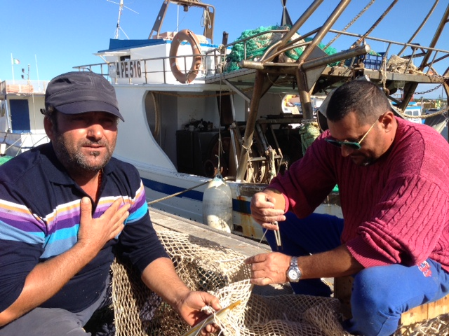 Lampedusan fisherman Pasquale Palmisano explains how he feels about efforts to rescue migrants. November 13, 2014. Photo by Trisha Thomas