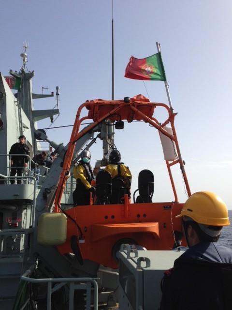 A delta rescue boat aboard the Portuguese open sea patrol vessel Viana do Castelo as sailors prepare to lower it into sea. November 13, 2014. Photo by Trisha Thomas