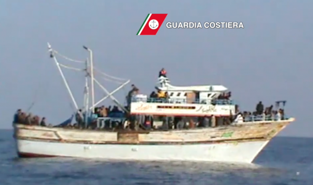 Freeze frame of Coast Guard video of a migrant ship heading towards Sicily on November 3, 2014.  There were 329 migrants on board.