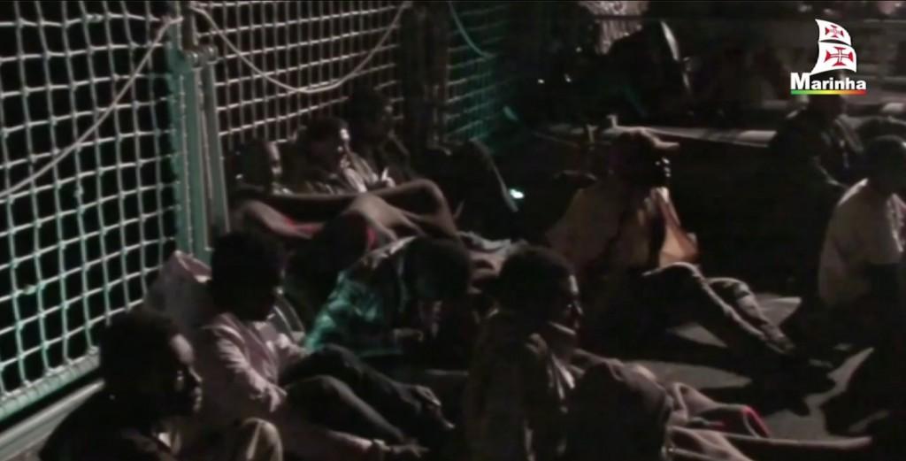Freeze frame of videio of migrants on deck of Portuguese vessel the Viana Do Castelo. November 14, 2014. Credit: Portuguese Navy