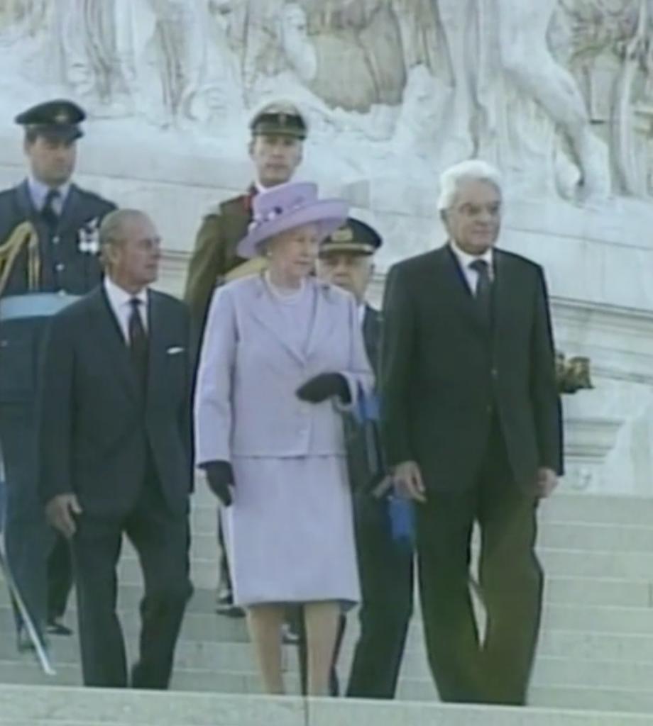 Then Defense Minister Sergio Mattarella with Queen Elizabeth II in Rome, 1999.  Freeze Frame of APTN video.