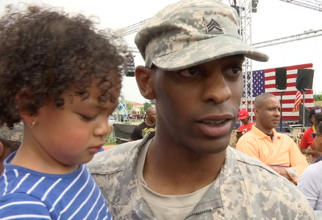 Arlington Chandler and his little girl shortly after listening to First Lady Michelle Obama at the US Army Garrison at Vicenza. June 19, 2015. Freeze Frame of video shot by AP Cameraman Gigi Navarra.