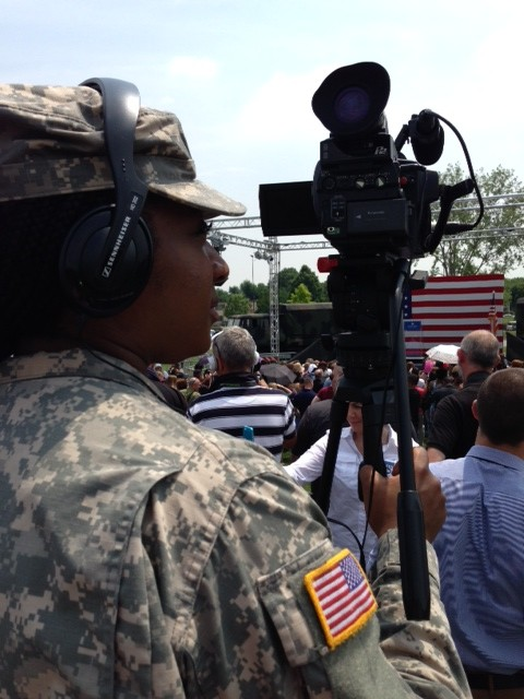 Combat camera specialist Gibson was in full fatigues and boots as she stood near me on the riser waiting for Michelle Obama to arrive. June 19, 2015. Photo by Trisha Thomas