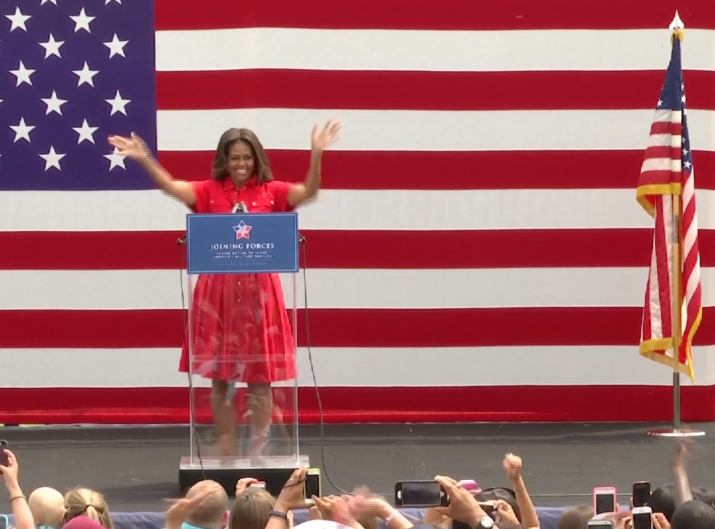 Michelle Obama greets the crowd at Vicenza Army Garrison in Northern Italy. June 19, 2015. Freeze frame of video shot by AP Television Cameraman  Gigi Navarra