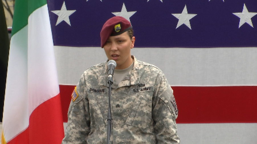 """Soldier-singer Amanda Donohue singing """"The Star Spangled Banner"""" prior to the arrival of First Lady Michelle Obama at Vicenza Army Garrison. June 19, 2015. Freeze frame of video shot by AP Television Cameraman Gigi Navarra"""