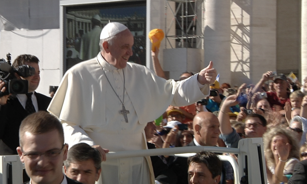 Pope Francis gives the thumbs-up to the crowd during his weekly audience in St. Peter's Square. September 18, 2013. Freeze frame of video shot by AP Television cameraman Gianfranco Stara