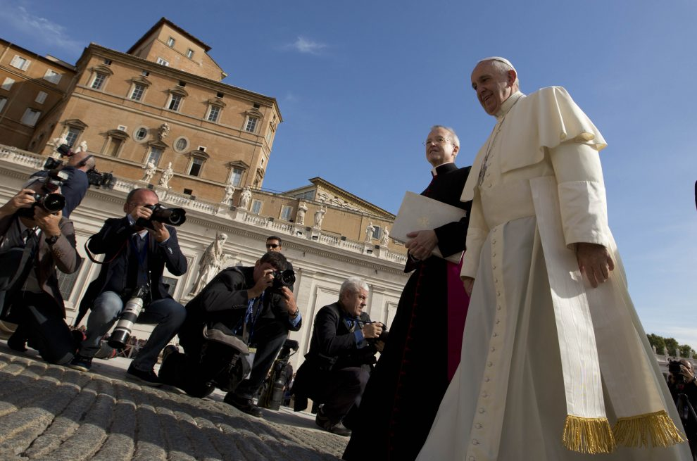 Pope Francis walking towards Saint Peter's Basilica to begin his weekly audience. September 9, 2015.  Photo by AP Photographer Alessandra Tarantino for Mozzarella Mamma