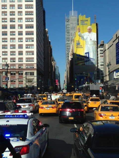 Welcome to New York says this big yellow poster with the image of Pope Francis. Photo by Trisha Thomas, September 24, 2015