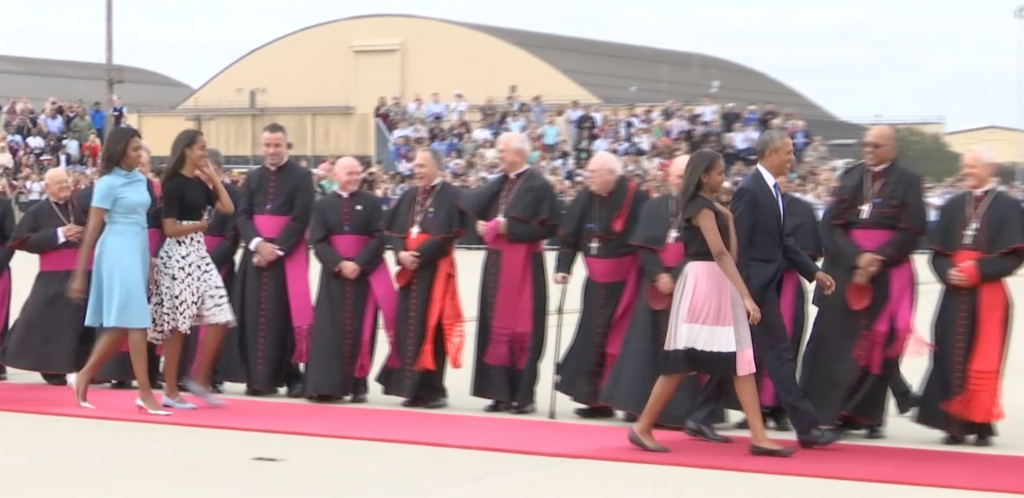 Obama family heads down red carpet to meet Pope Francis as gets off plane. Freeze frame of video shot by AP Television video-journalist Paolo Santalucia. September 22, 2015