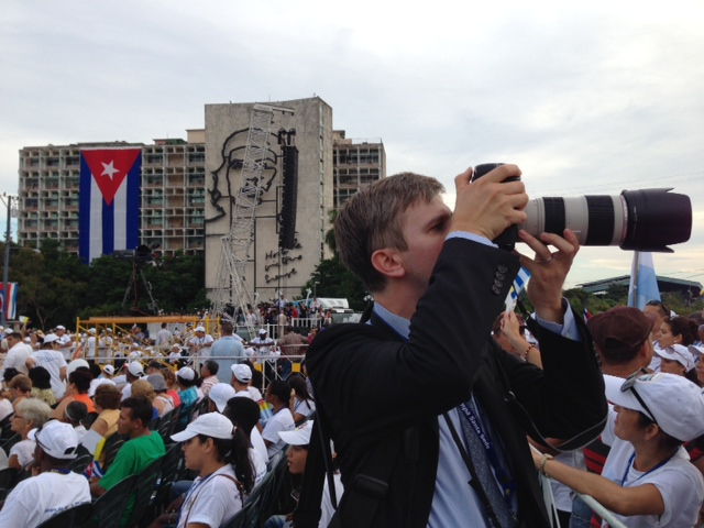 Catholic News Service Photographer Paul Haring takes a photo of the crowd waiting for Mass with Pope Francis in Plaza de la Revolucion, Havana, Cuba. September20, 2015. Photo by Trisha Thomas