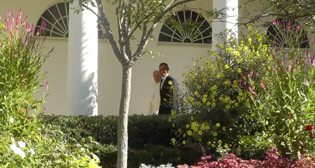 President Obama and Pope Francis walk past the Rose Garden at the make their way to the Oval Office. Freeze frame of video shot by Trisha Thomas for AP Television. September 23, 2015
