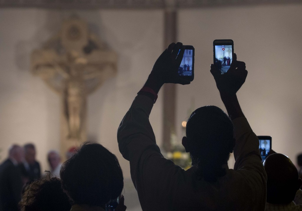 People raising their cell phones to take a photo of Pope Francis at St. Patrick's Church in Washington. September 24, 2015. Photo by AP Photographer Alessandra Tarantino for Mozzarella Mamma