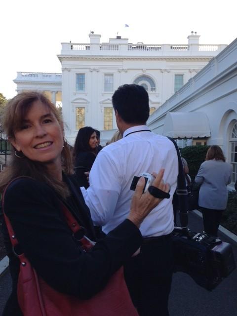 Trisha Thomas aka Mozzarella Mamma checking the setting on the little camera as the Vatican Press Corps prepares to enter the White House. Photo by Paolo Santalucia, September 23, 2015
