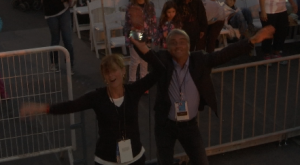 """Trisha Thomas of AP Television and Marco Sanga of RAI kicking up their heels to """"We are Family"""" at the Festival of the Family in Philadelphia. September 26, 2015 Freeze frame of video shot by AP video-journalist Paolo Santalucia"""