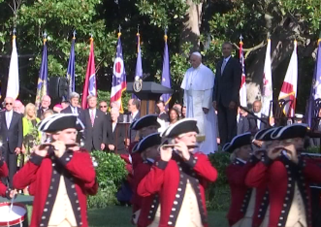 Pope Francis and President Obama stand at attention as the US Army Fife and Drum Corps march past on the South Lawn of the White House. Freeze frame of video shot by AP Television video-journalist Paolo Santalucia. September 23, 2015