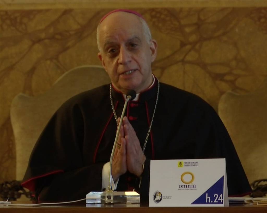 Archbishop Rino Fisichella at a press conference on the Jubilee of Mercy starting December 8th. December 3, 2015. Freeze frame of video shot by AP VJ Paolo Santalucia.