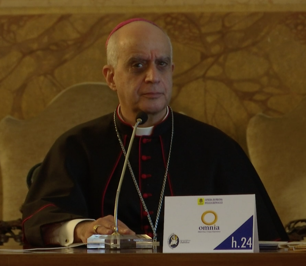 Archbishop Rino Fisichella gets irritated over question on indulgence at a press conference in Rome. December 3, 2015.  Freeze frame of video shot for AP Television by AP VJ Paolo Santalucia
