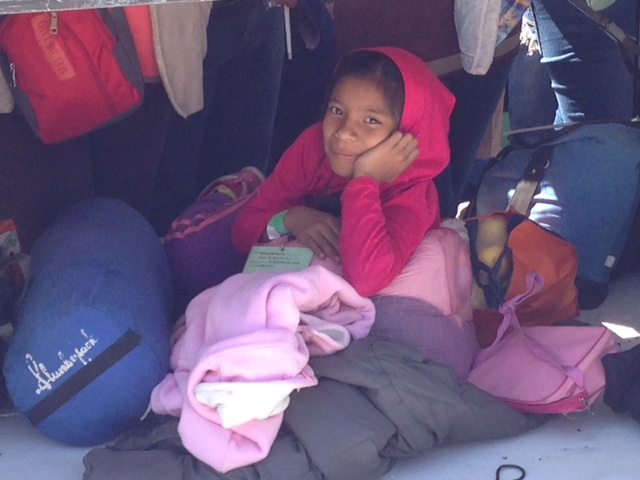Guadalupe Martinez enjoys a little shade under tables set up near the press platform at the Papal Mass in Ecatepec, Mexico City. Photo by Trisha Thomas, February 14, 2016
