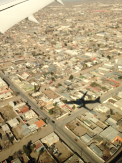 The shadow of the plane carrying Pope Francis as it lands in Cuidad Juarez February 17, 2015. Photo by Trisha Thomas