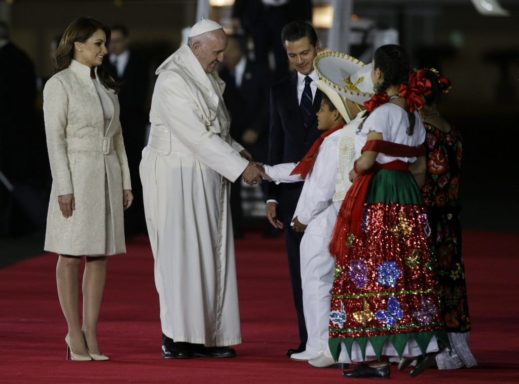 Pope Francis is welcomed by Mexico's President Enrique Pena Nieto and his wife Angelica Rivera upon his arrival in Mexico City, Friday, Feb. 12, 2016. Photo by AP Photographer Gregorio Borgia (for Mozzarella Mamma)