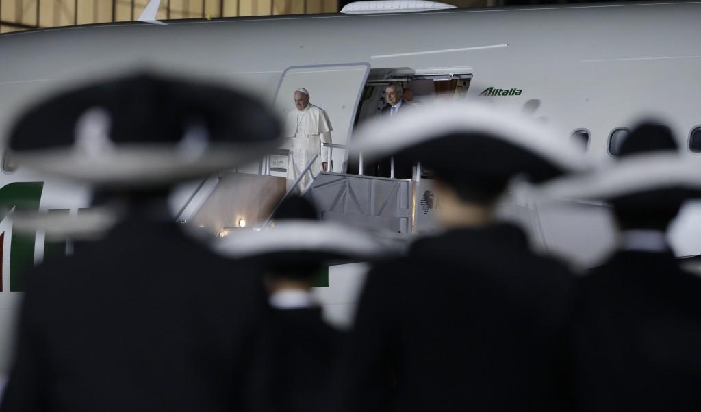 Pope Francis steps off airplane in Mexico City. February 12, 2016. Photo by AP Photographer Gregorio Borgia (for Mozzarella Mamma)