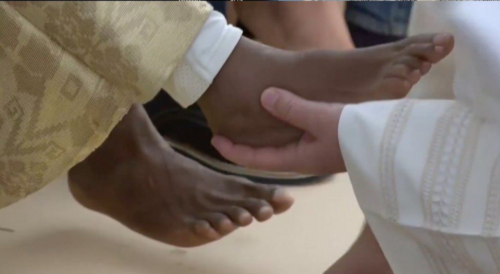 Pope Francis washes foots of refugees as Castel Nuovo di Porto refugee center near Rome on Holy Thursday. March 24, 2016