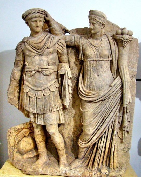 Statue of Emperor Nero with his mom Agrippina in the Aphrodisias Museum in Turkey. She definitely has her hands in his hair or perhaps she is crowning him. Credit: Leon Mauldin
