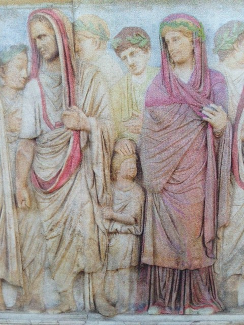 Julia in a procession behind her husband Agrippa and a child - Photo of a screen in the Ara Pacis Museum with coloring as the original relief on the side of the Ara Pacis would have been. Photo by Trisha Thomas, May 2016