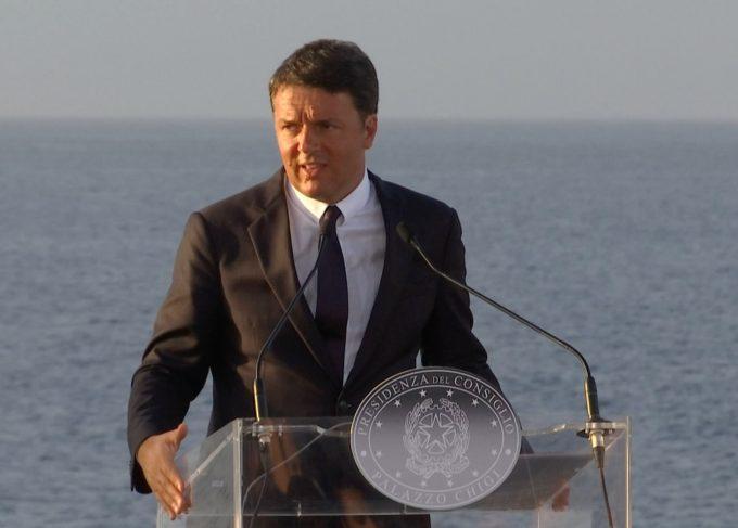 Italian Prime Minister Matteo Renzi speaking to the press aboard the Italian aircraft carrier Garibaldi. August 22, 2016. Freeze frame of video shot by AP Television Cameraman Gianfranco Stara