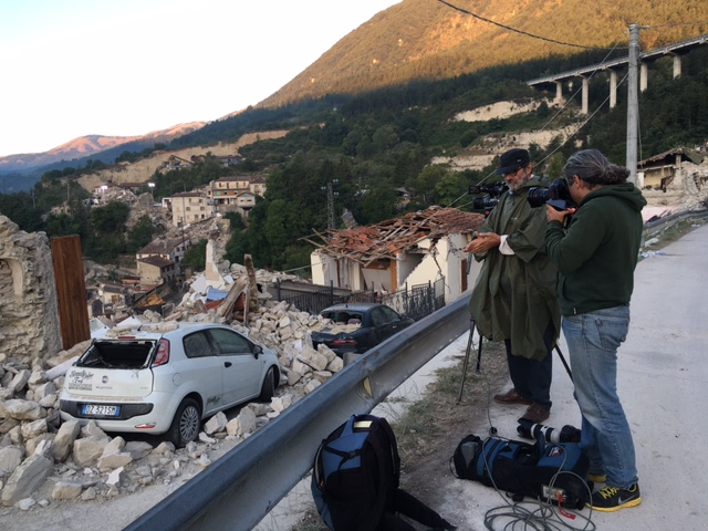 AP cameraman Gianfranco Stara and AP photographer Gregorio Borgia at dawn in Pescara Del Tronto one day after the earthquake. Photo by Trisha Thomas, August 25, 2016