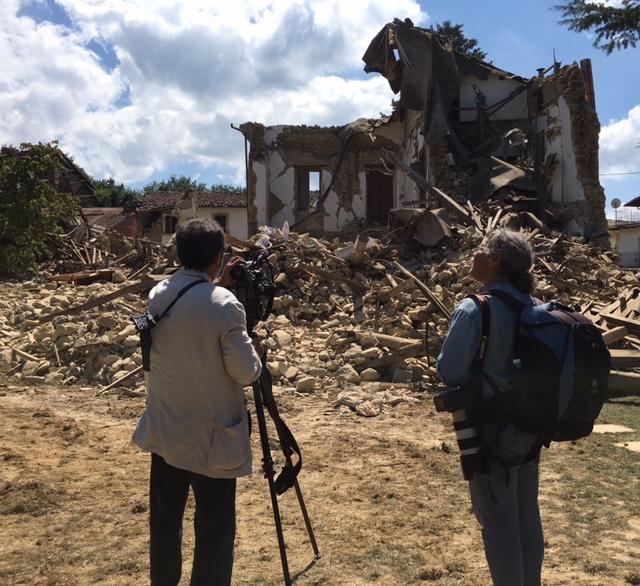 AP team of cameraman Gianfranco Stara and photographer Gregorio Borgia shooting destroyed home of British family in Sommati. Photo by Trisha Thomas, August 26, 2016