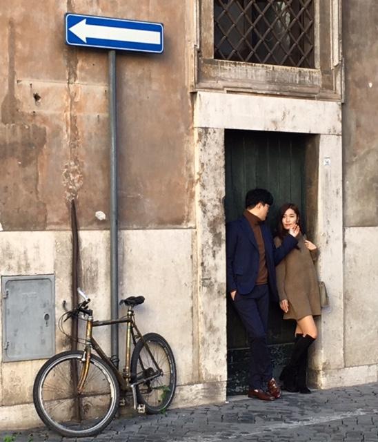 Chinese couple poses for a photo on Via Della Gatta Rome, Februaury 10, 2016. Photo by Trisha Thomas