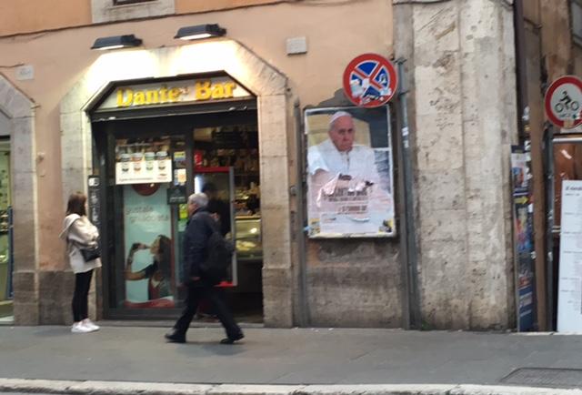 Pope Poster outside a bar on Via del Corso in Rome. February 9, 2016. Photo by Trisha Thomas