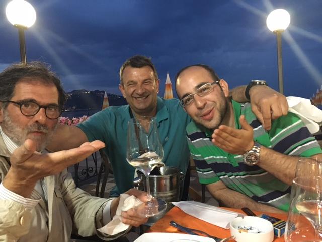 Gianfranco Stara, Srdjan Nedeljkovic and Hakan Kaplan blowing a kiss to AP Television Senior Producer Maria Grazia Murru at a restaurant in Giardini Naxos. May 25, 2017 - Photo by Trisha Thomas