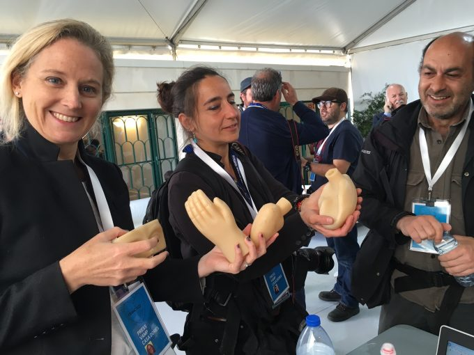 AP team of Vatican Correspondent Nicole Winfield, Rome photographer Alessandra Tarantino and Lisbon photographer Armando Franca examining various wax body parts bought at a store in Fatima. Photo by Trisha Thomas, May 13, 2017. Fatima, Portugal.