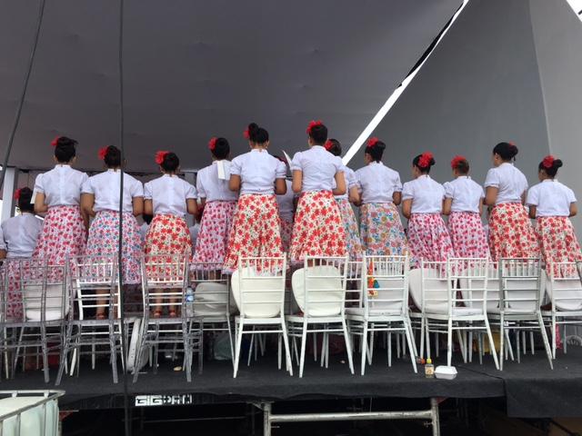 Young women singing at papal Mass in Villavicencio. September 8, 2017. Photo by Trisha Thomas